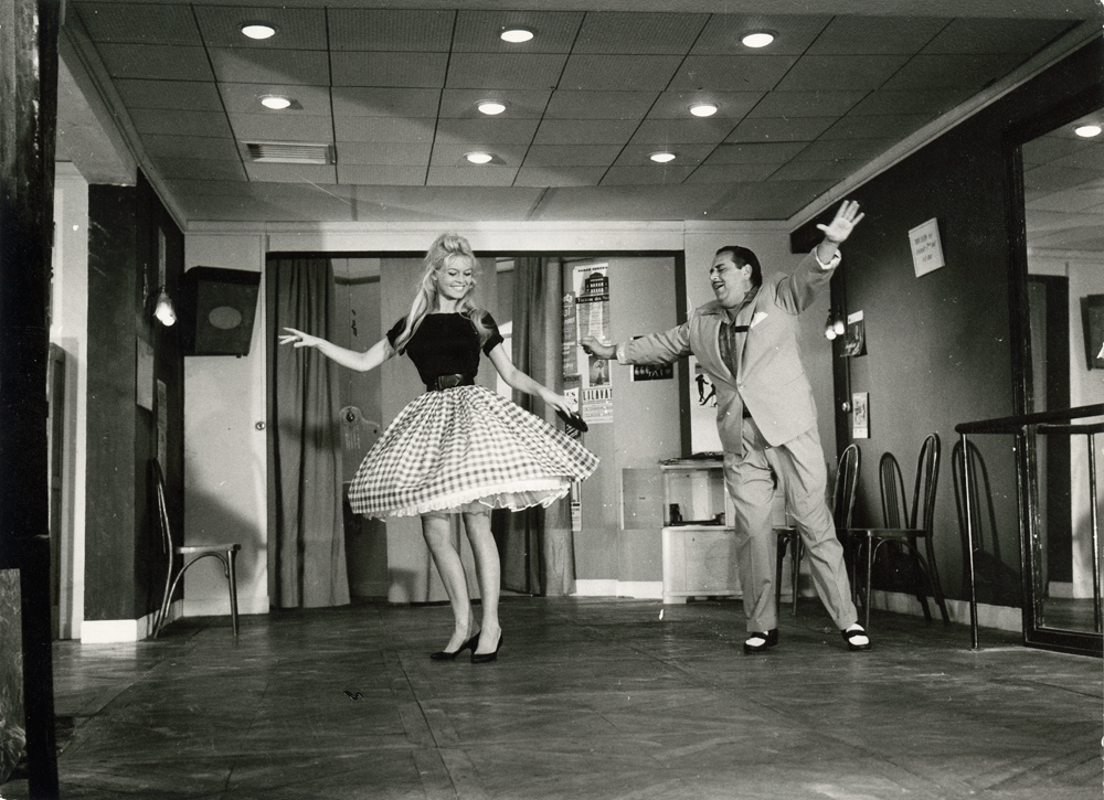 The 'very lively' mambo in Come Dance with Me! Brigitte is dancing with Dario Moreno in an outfit designed by couturier Jacques Esterel, her hair styled by Carita. © Cinémathèque française, from Brigitte Bardot: My Life in Fashion (Flammarion, 2016).