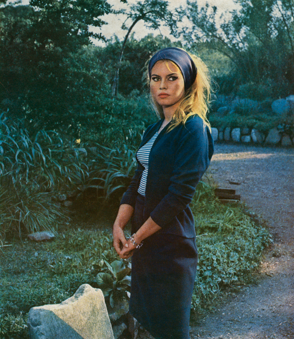 On the set of Contempt at the Cinecittà studios, Italy. With the famous wide headband holding back her hair, an accessory she invented and wore for the purposes of the film, 1963. © Cinémathèque française, from Brigitte Bardot: My Life in Fashion (Flammarion, 2016).
