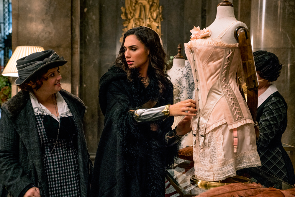 Diana Prince (Gal Gadot) with Etta (Lucy Davis) shopping for inconspicuous clothes.
