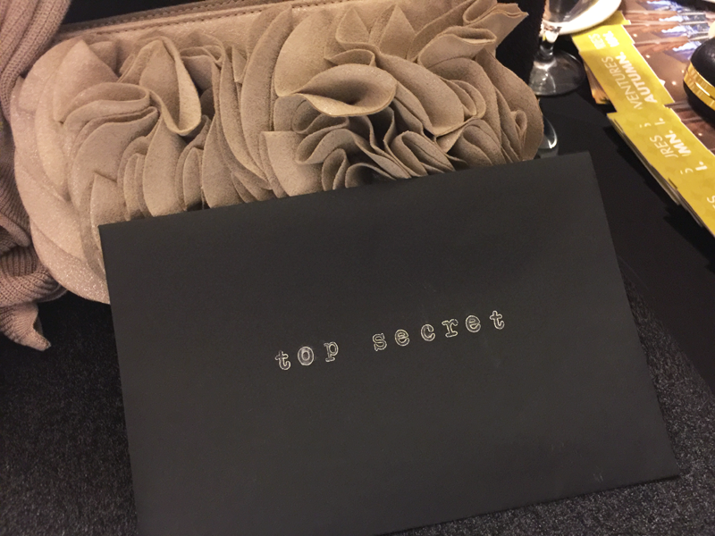 Each Agent of Chic received a top secret envelope filled with covert intel during the Chic Spy Day Soiree.