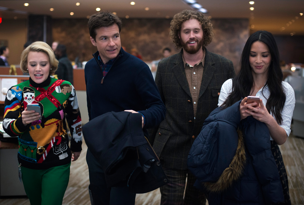 "Kate McKinnon, Jason Batemen, T.J. Miller, and Olivia Munn in ""Office Christmas Party."" (Source: Paramount Pictures)"