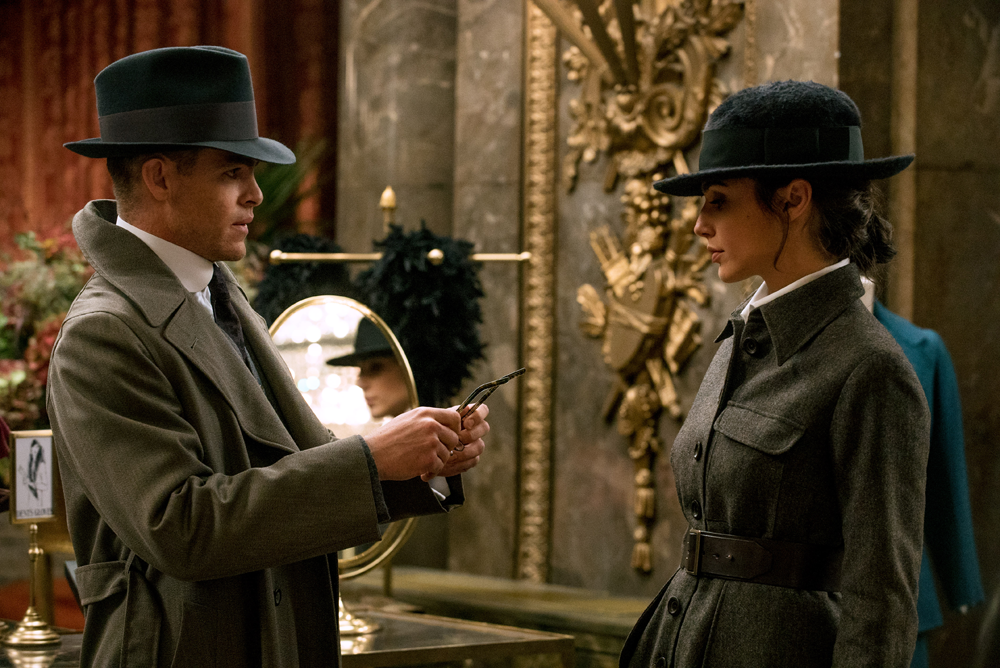 Steve Trevor (Chris Pine) helping Diana Prince (Gal Gadot) with her new look.