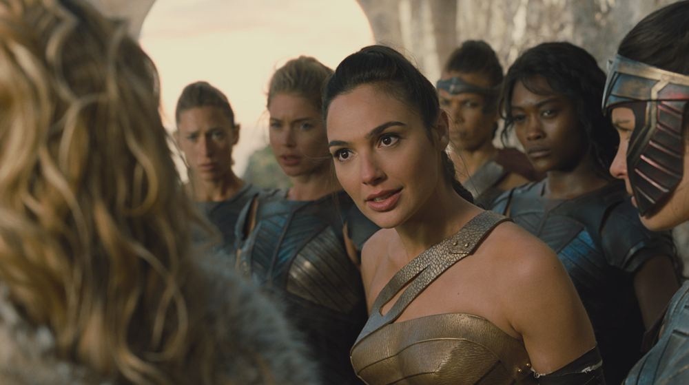 Diana Prince (Gal Gadot) surrounded by Amazonians.